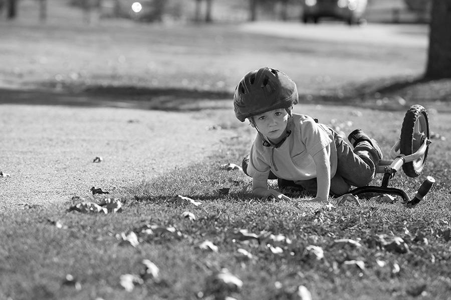 boy falling over on a bike