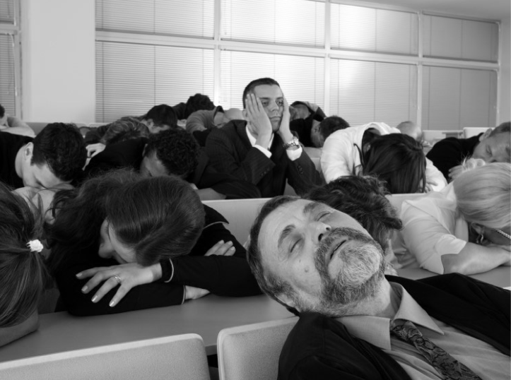 People sleeping in a meeting